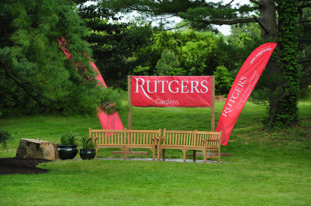 wooden benches with red Rutgers signs above