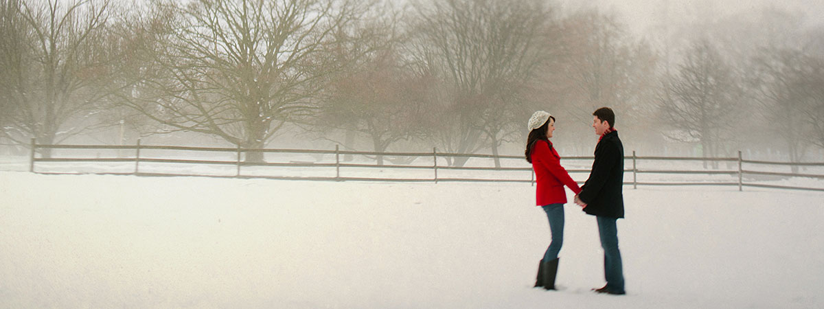 Couple in Garden with Snow