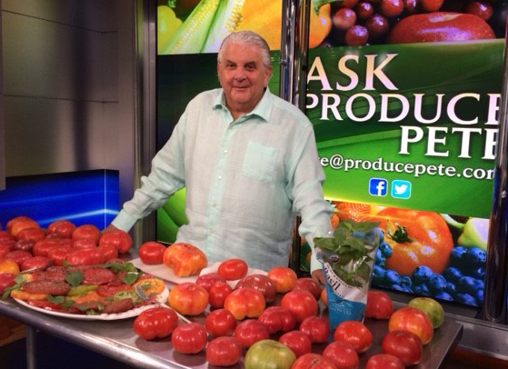 television personality Produce Pete, on set, standing next to a table of tomatoes