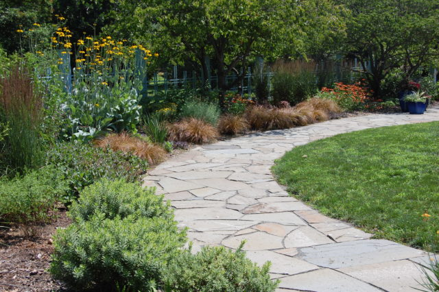 curved, stone walkway in garden