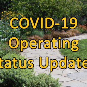 """Photo of a path through gardens with text """"COVID-19 Operating Status Updates"""""""
